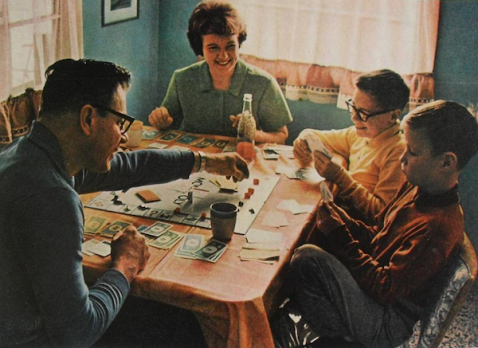 family-playing-monopoly-vintage